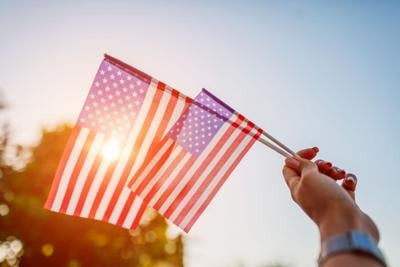 Woman holding USA flag. Celebrating Independence Day of America