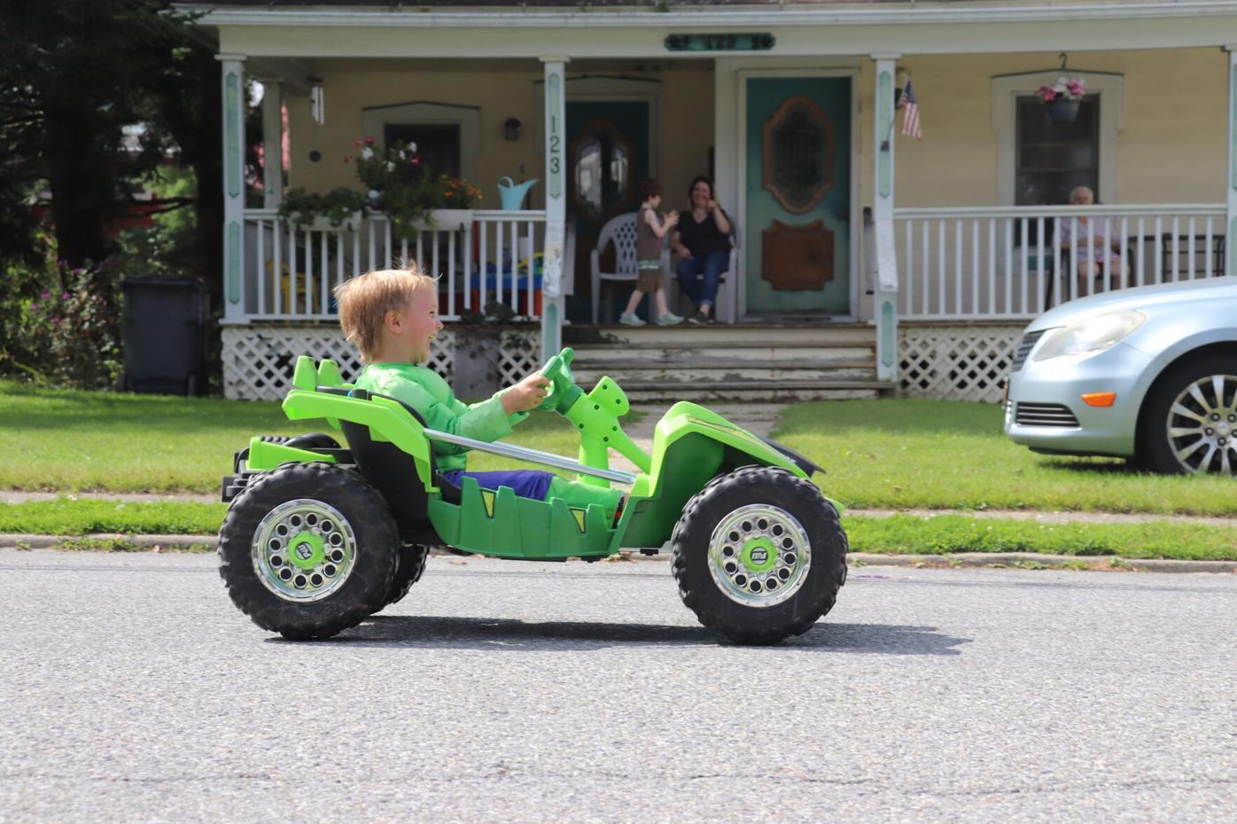 A young parade participant drives down Main.JPG