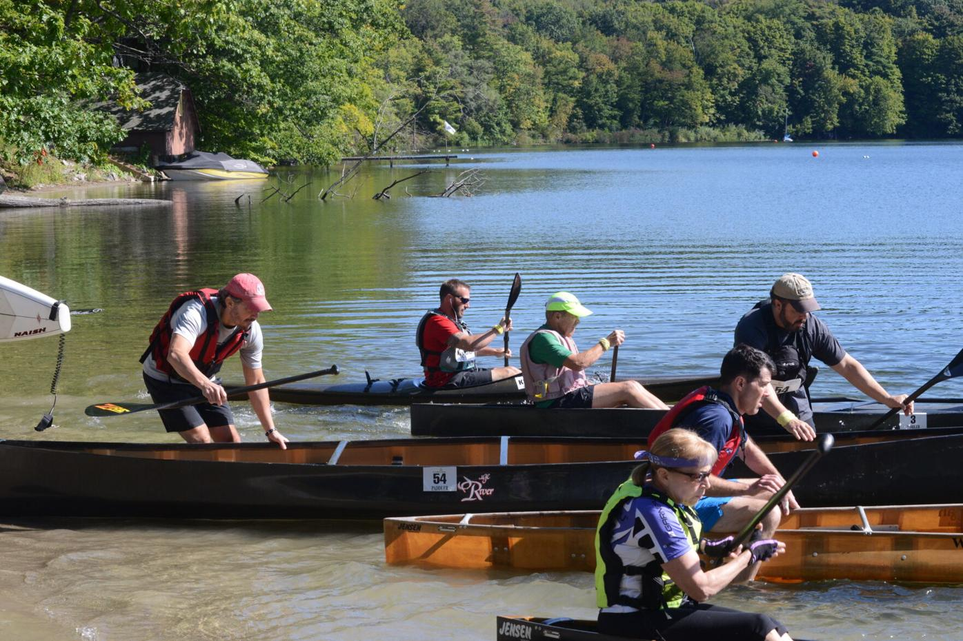 Boaters getting into canoes