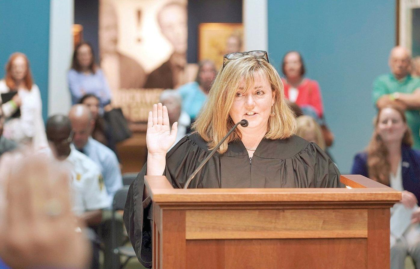 In 'the happiest courtroom' in the state, 18 become US citizens