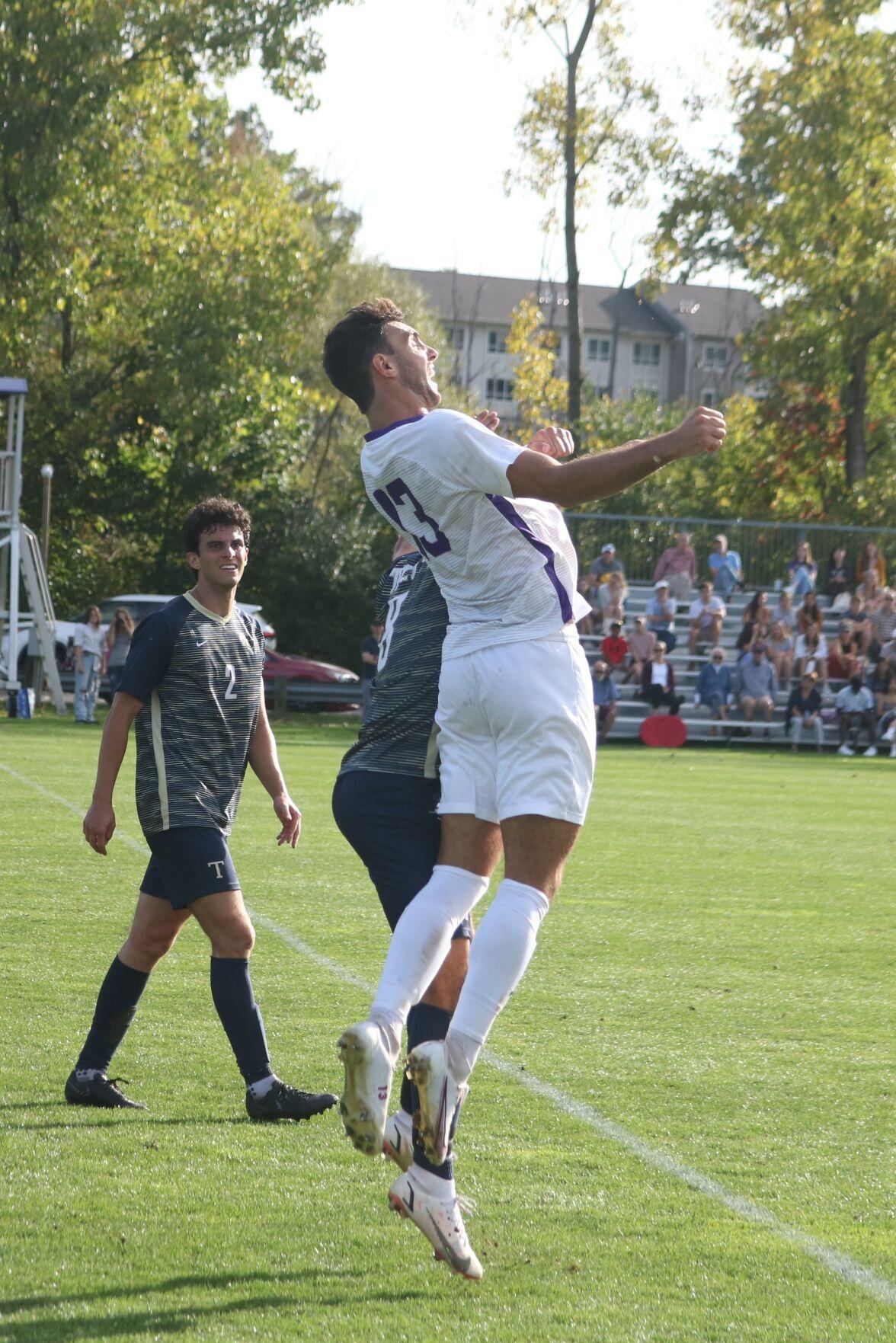 dan rayhill heads the ball