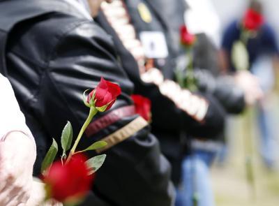 Veterans hold roses