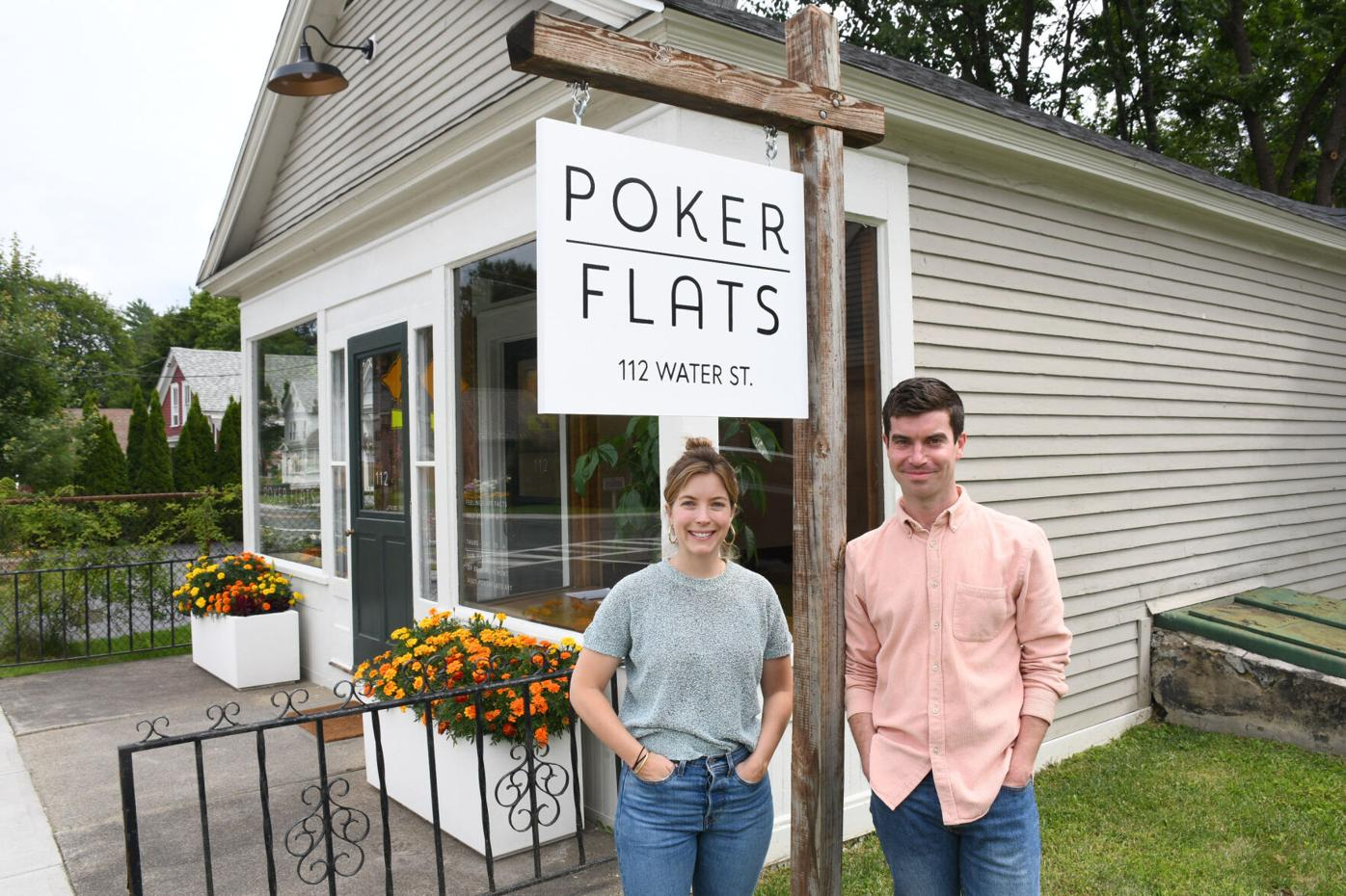 Izzy Lee and Jared Quinton stand in front of the Poker Flats Gallery