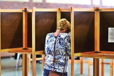 Voter casts a ballot in North Adams City Hall (copy) (copy)
