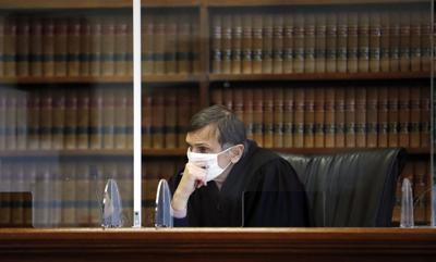 Judge John Agostini listens to details of the allegations against Conrad Mainwaring