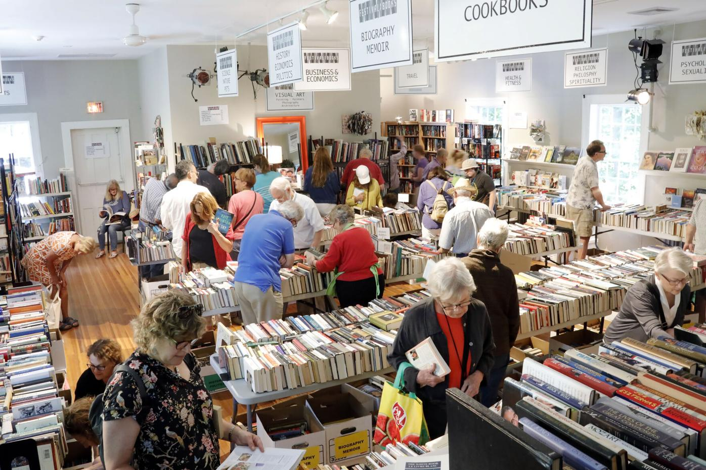 People search for book at a book fair