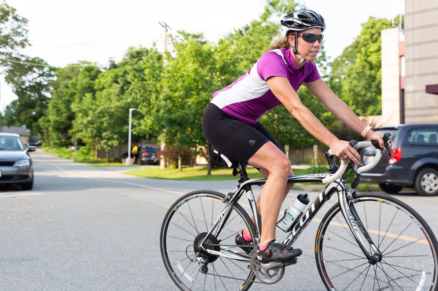 Female biker riding road bike