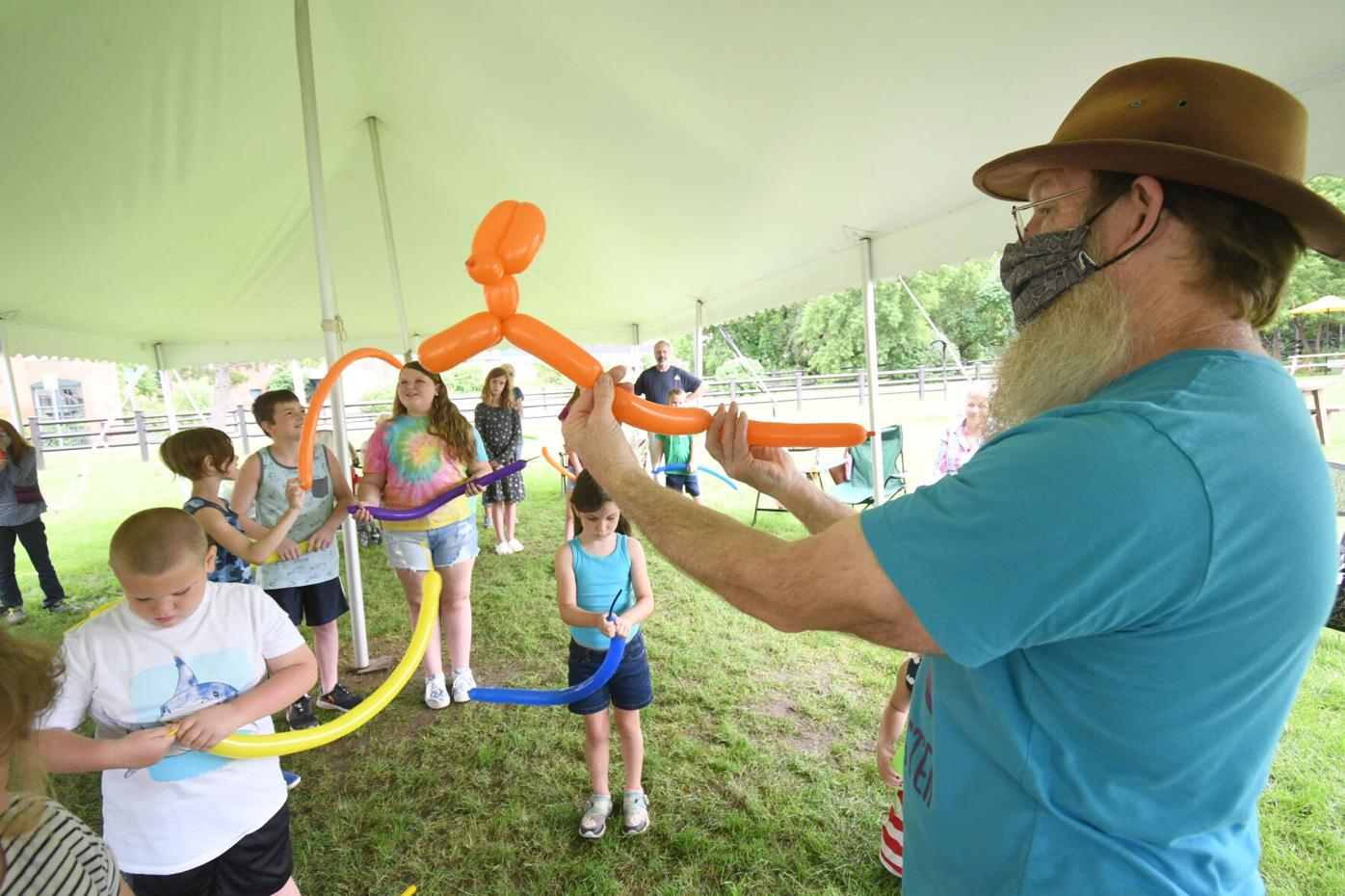 Ed shows kids how to make balloon animals