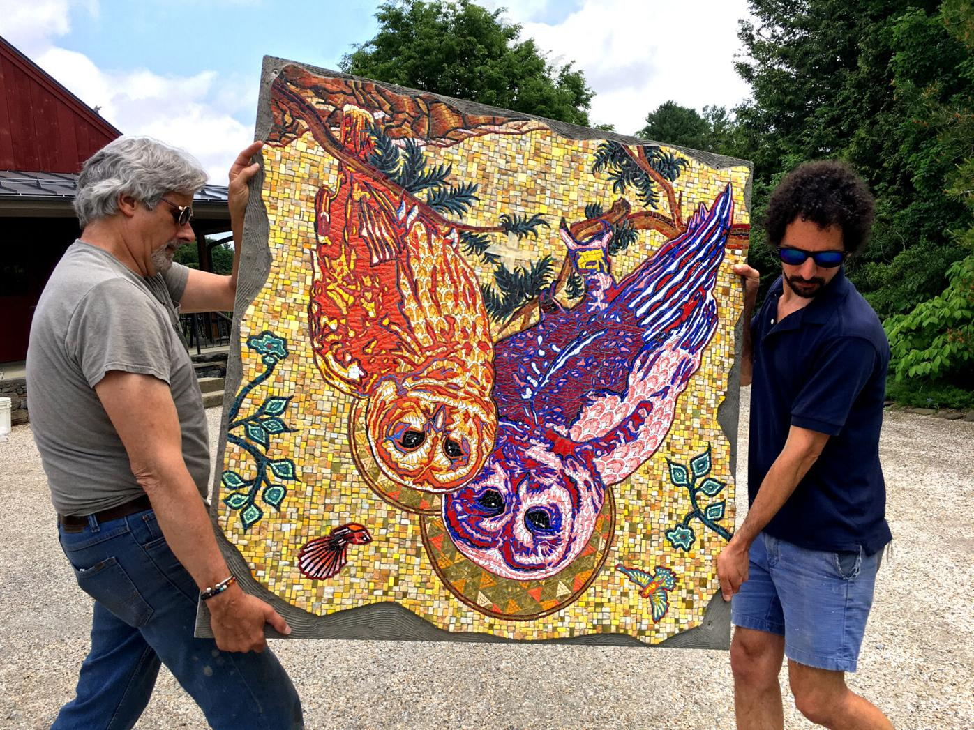 """Peter D. Gerakaris (right) with Stephen Miotto, carrying """"Spotted Owl Mosaic"""""""