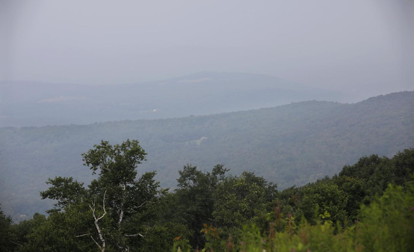 haze over mountains with trees
