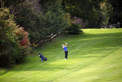 Tim Kaley hits golf ball