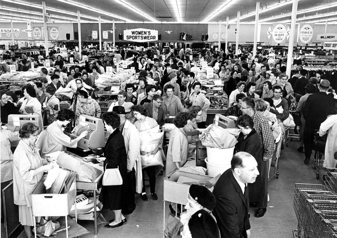 Black and white photo of packed store