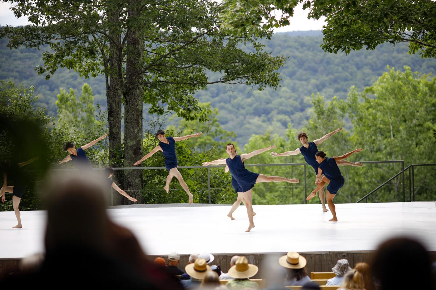 dancers perform on outdoor stage