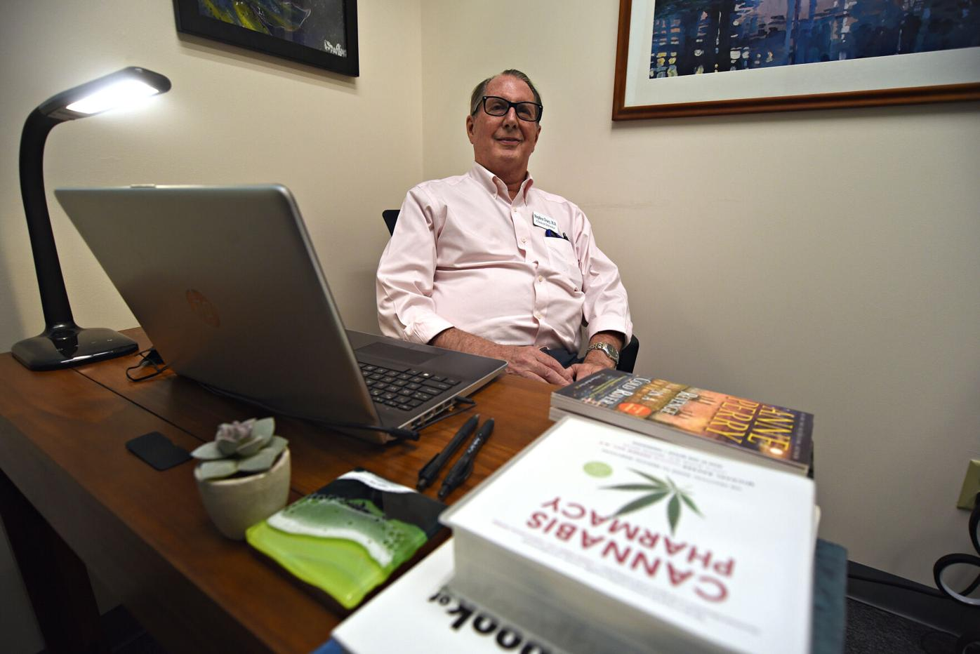 Dr. Stephen Tracy behind his desk at Berkshire Cannabis Connect in Pittsfield