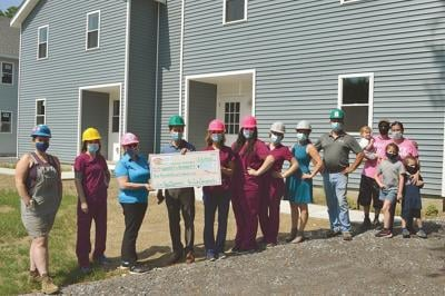 County Fare: New Life Chiropractic raises $10,000 for Habitat for Humanity