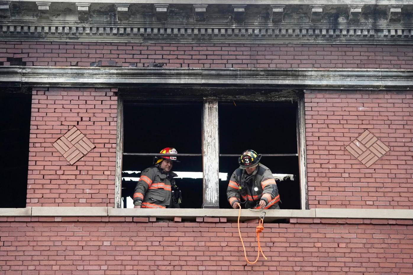 Firefighters in building window