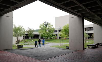 Three people walking on college campus