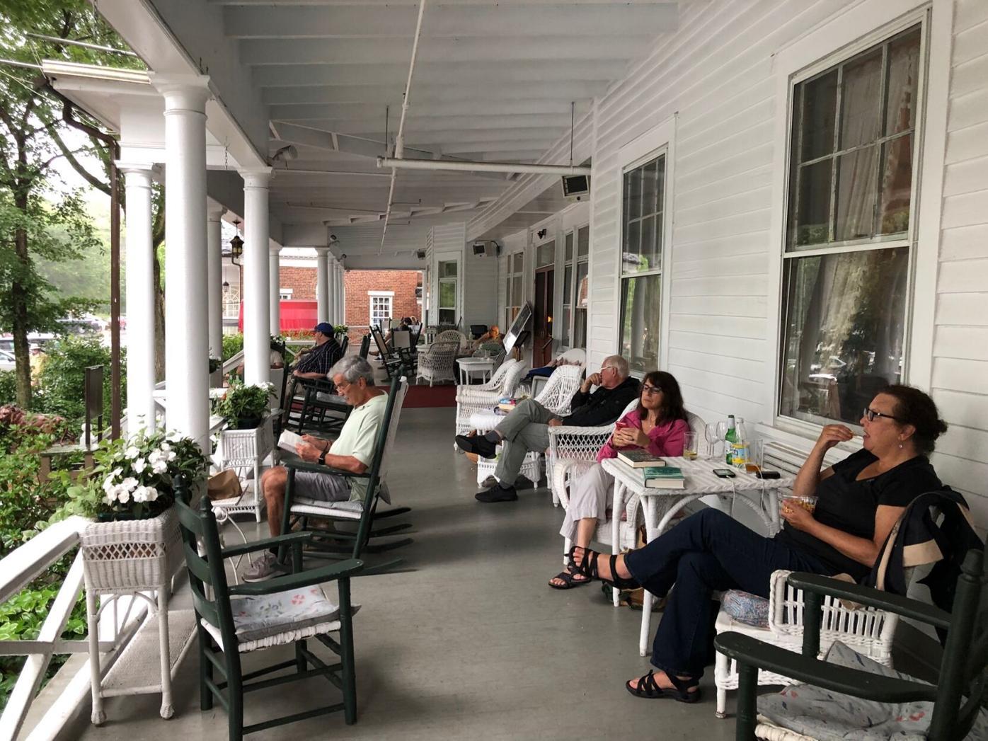 People sit on porch watching rain