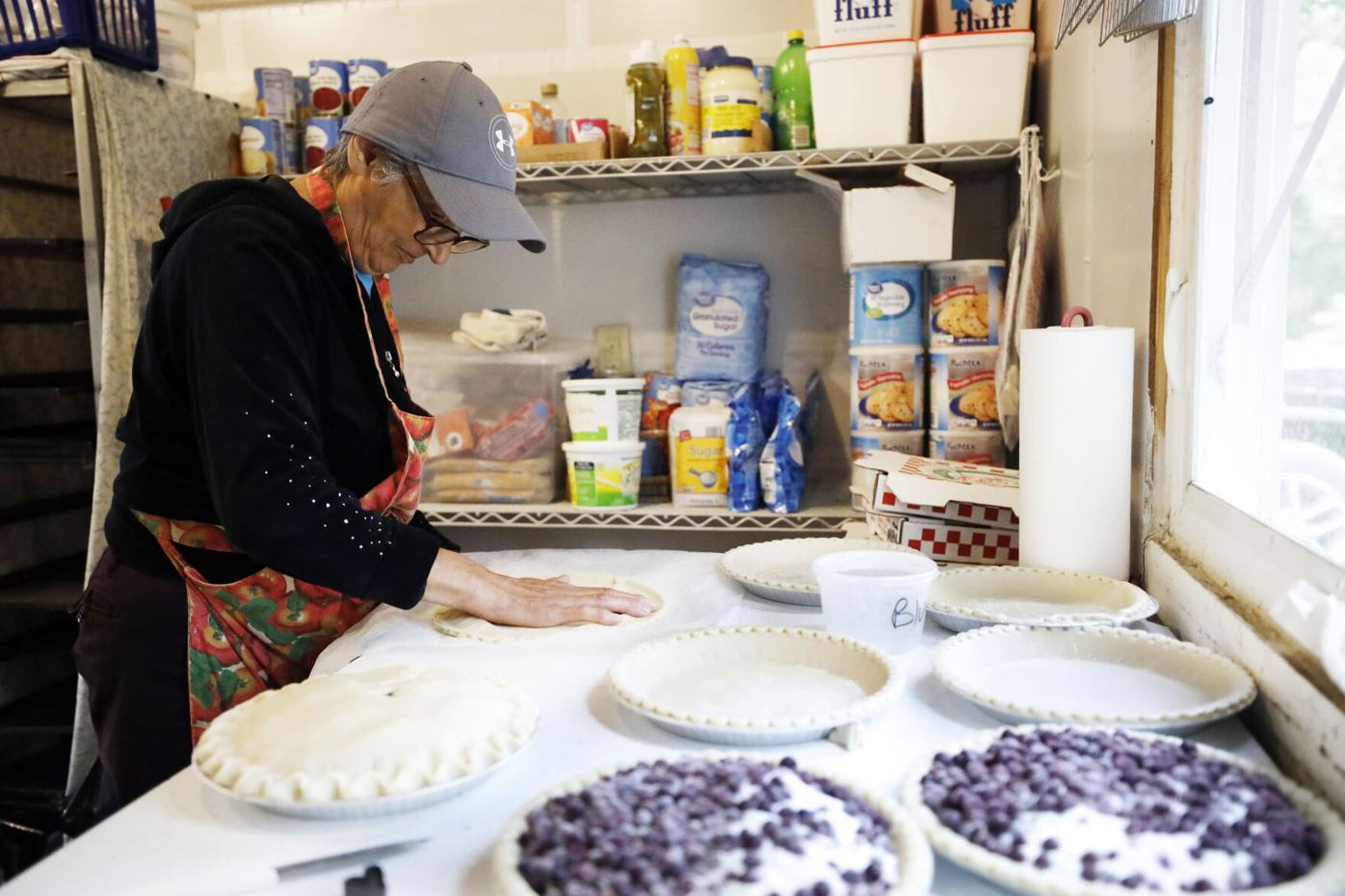 woman makes blueberry pies