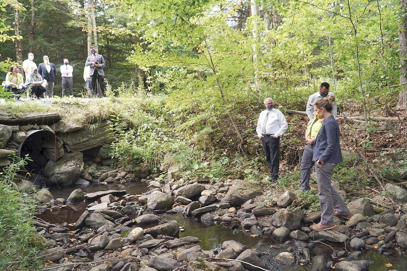 State, local officials gather in Becket to announce new grants for culvert work