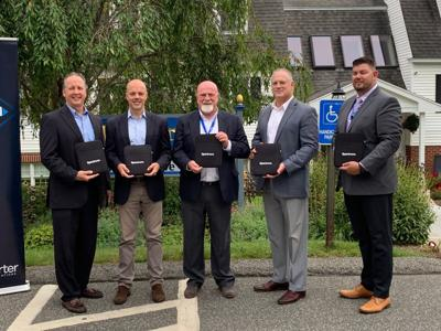 Hillcrest officials with new tablets