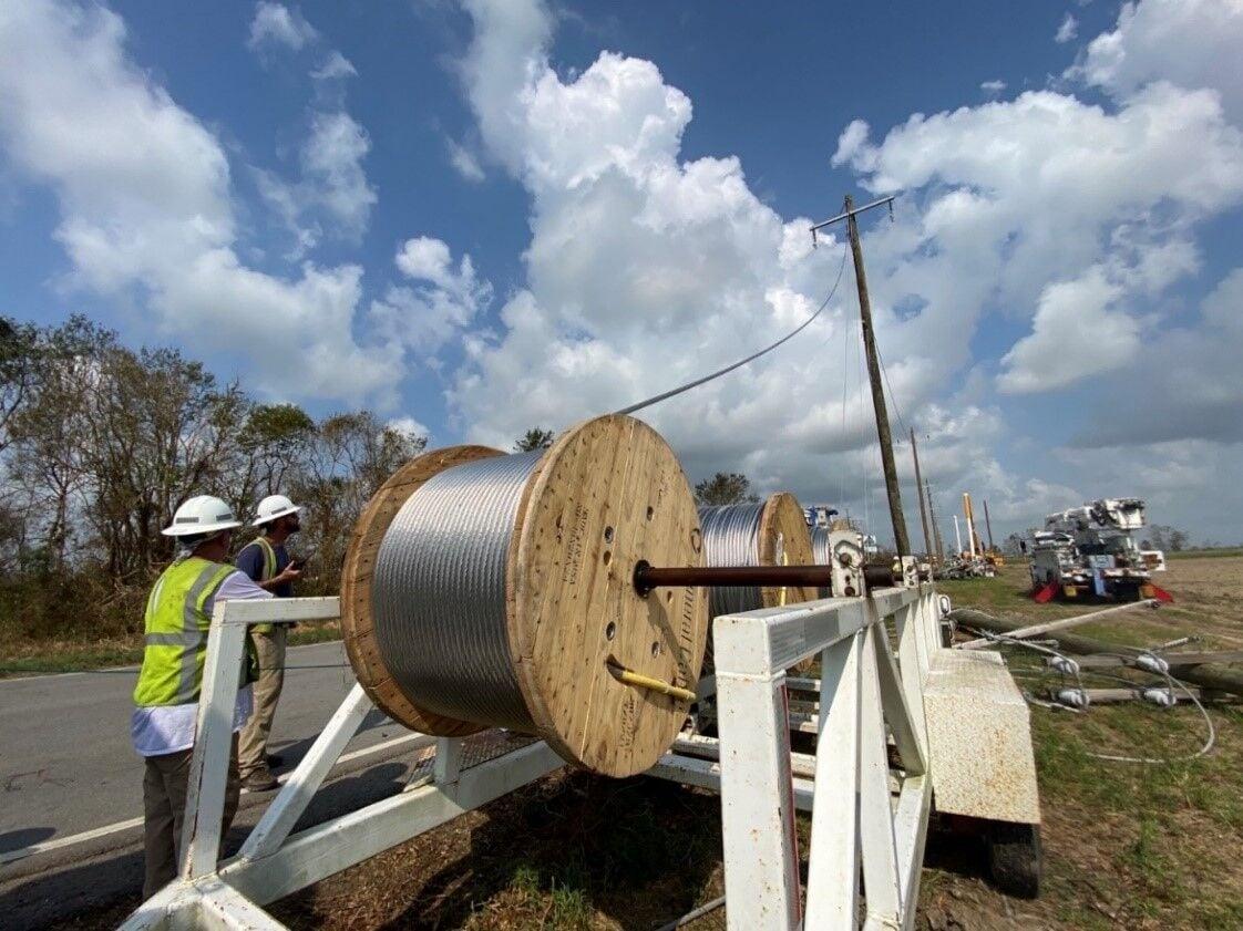 Crews Replacing Wires.jpg