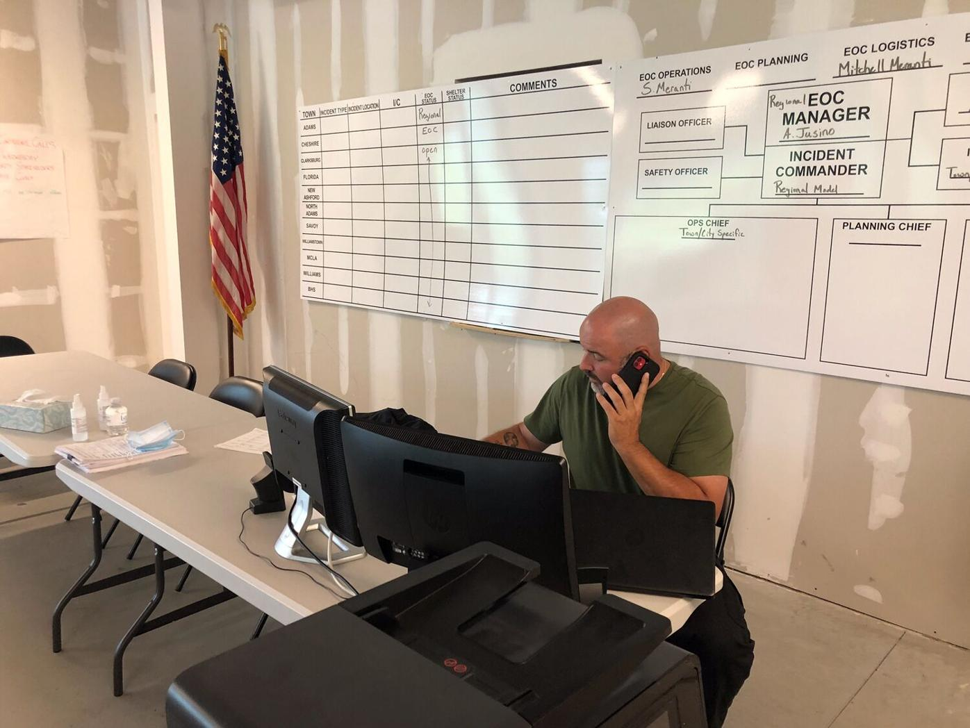 Man on phone at storm command center