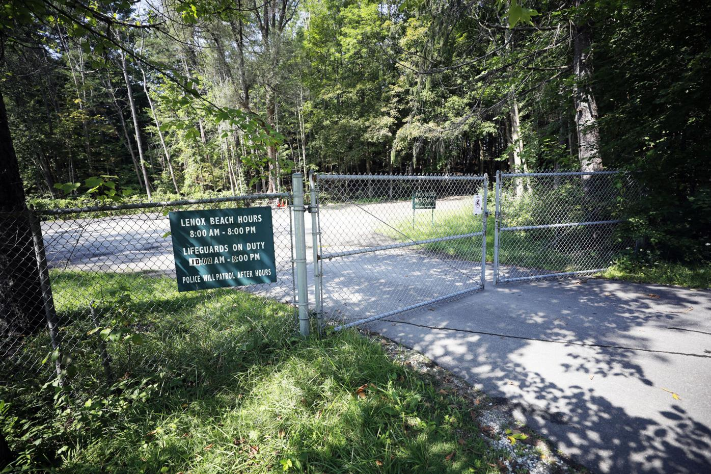 no swimming warning sign about e. coli posted on beach gate