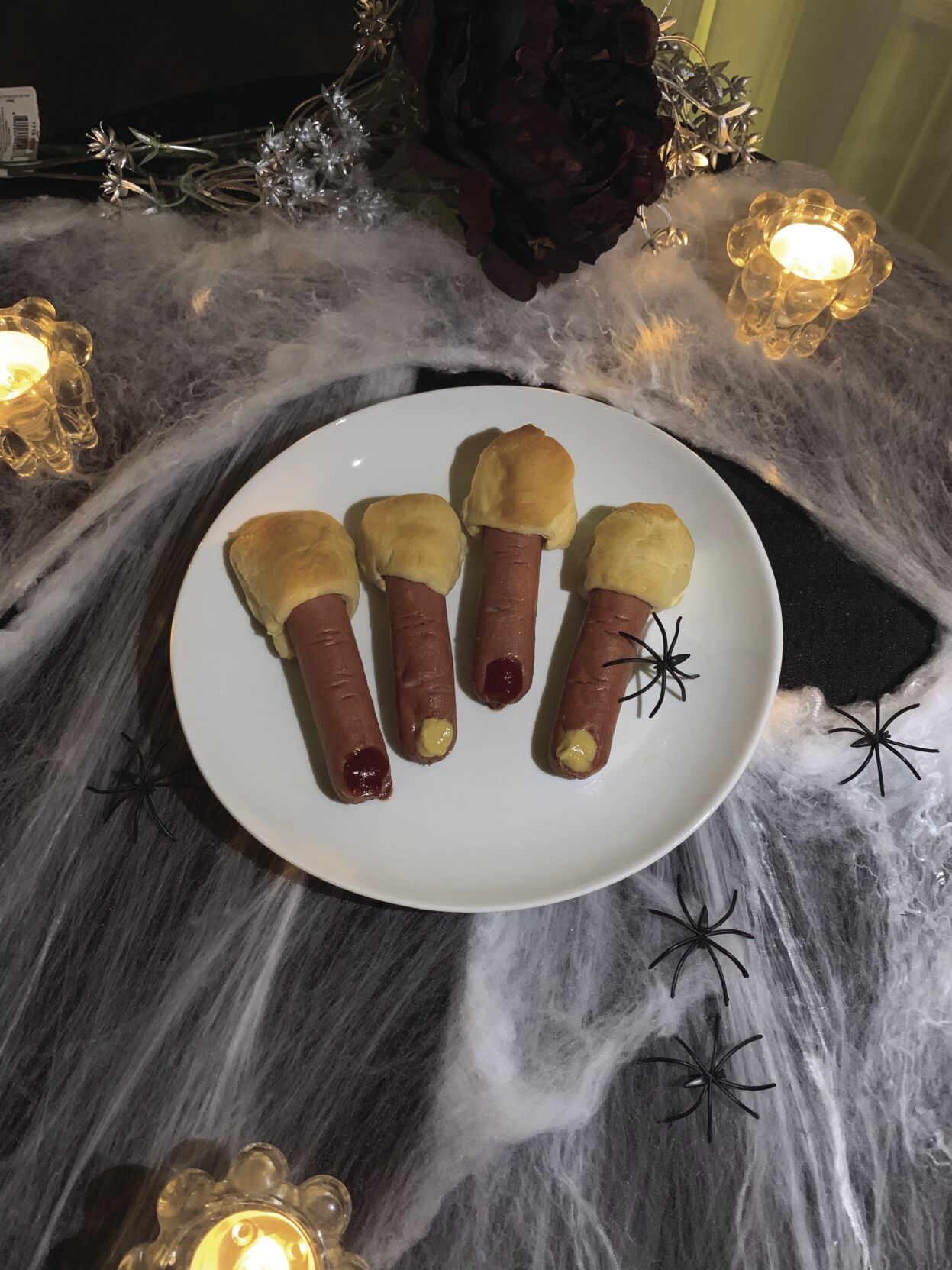Hot dogs on a spooky plate