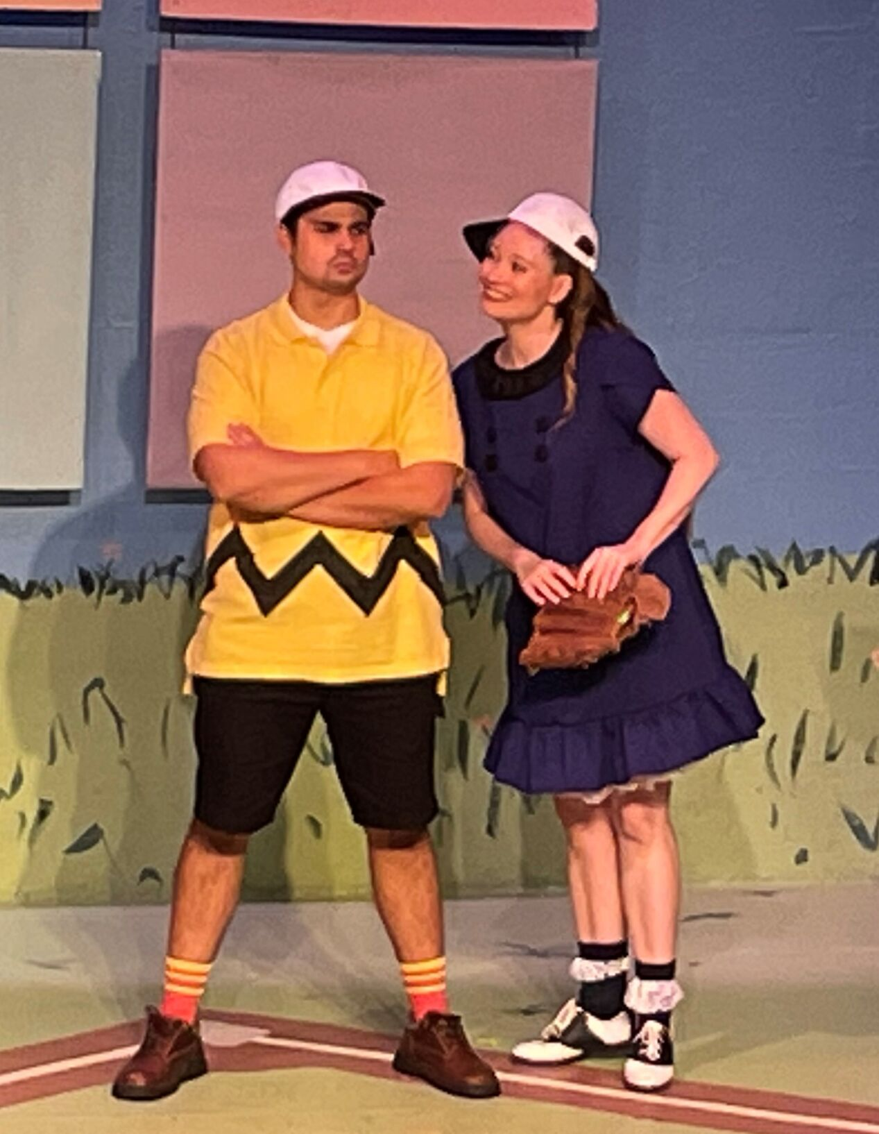 Charlie Brown and Lucy standing on stage