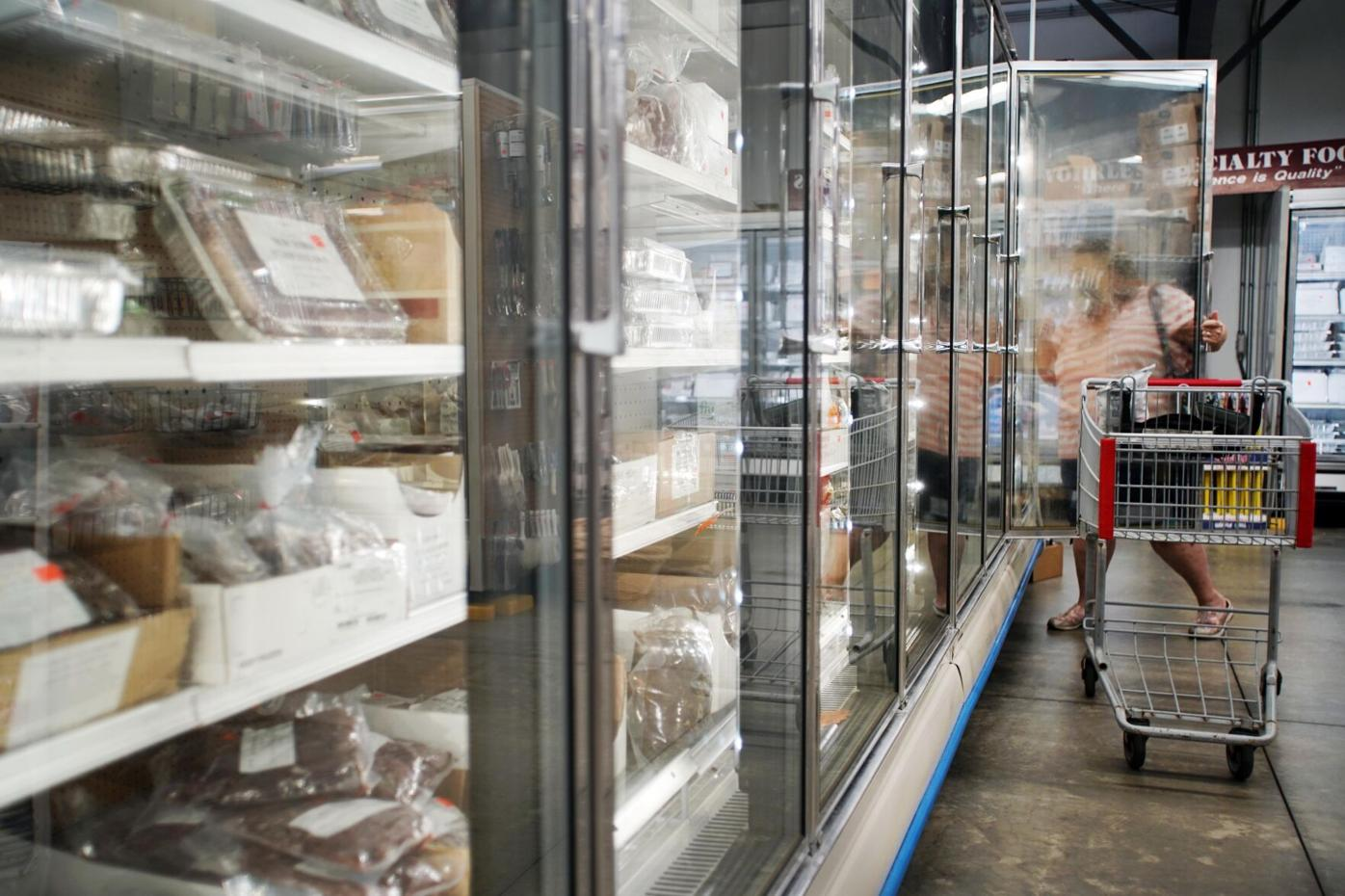 A woman shops in the freezer section at Wohrle's