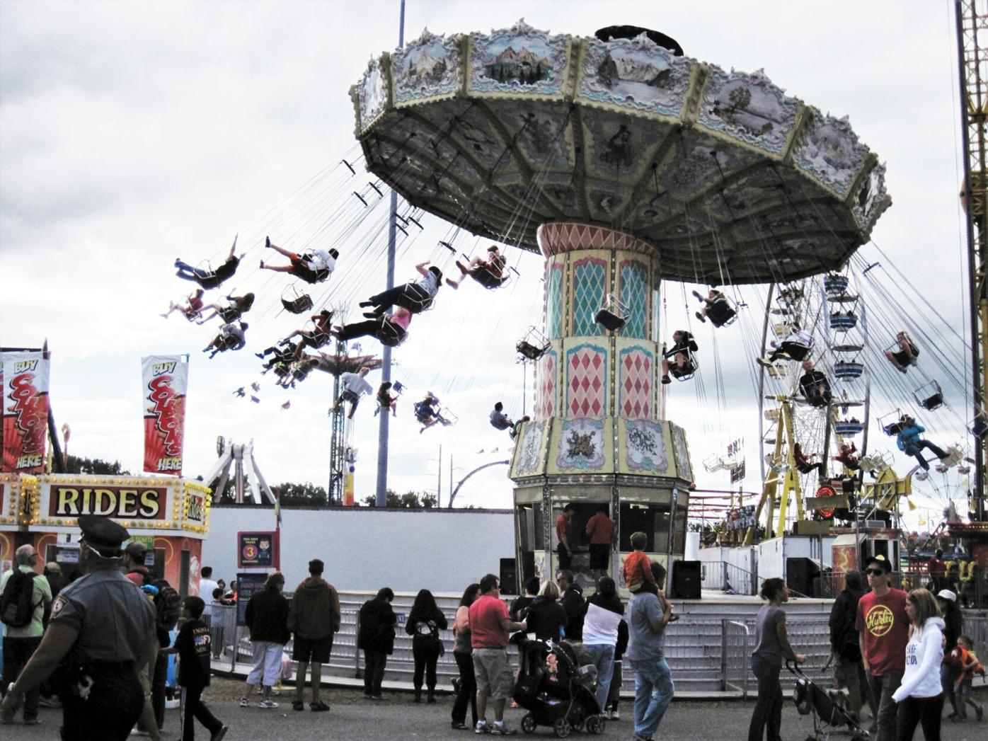 People ride a Swing Carousel at The Big E
