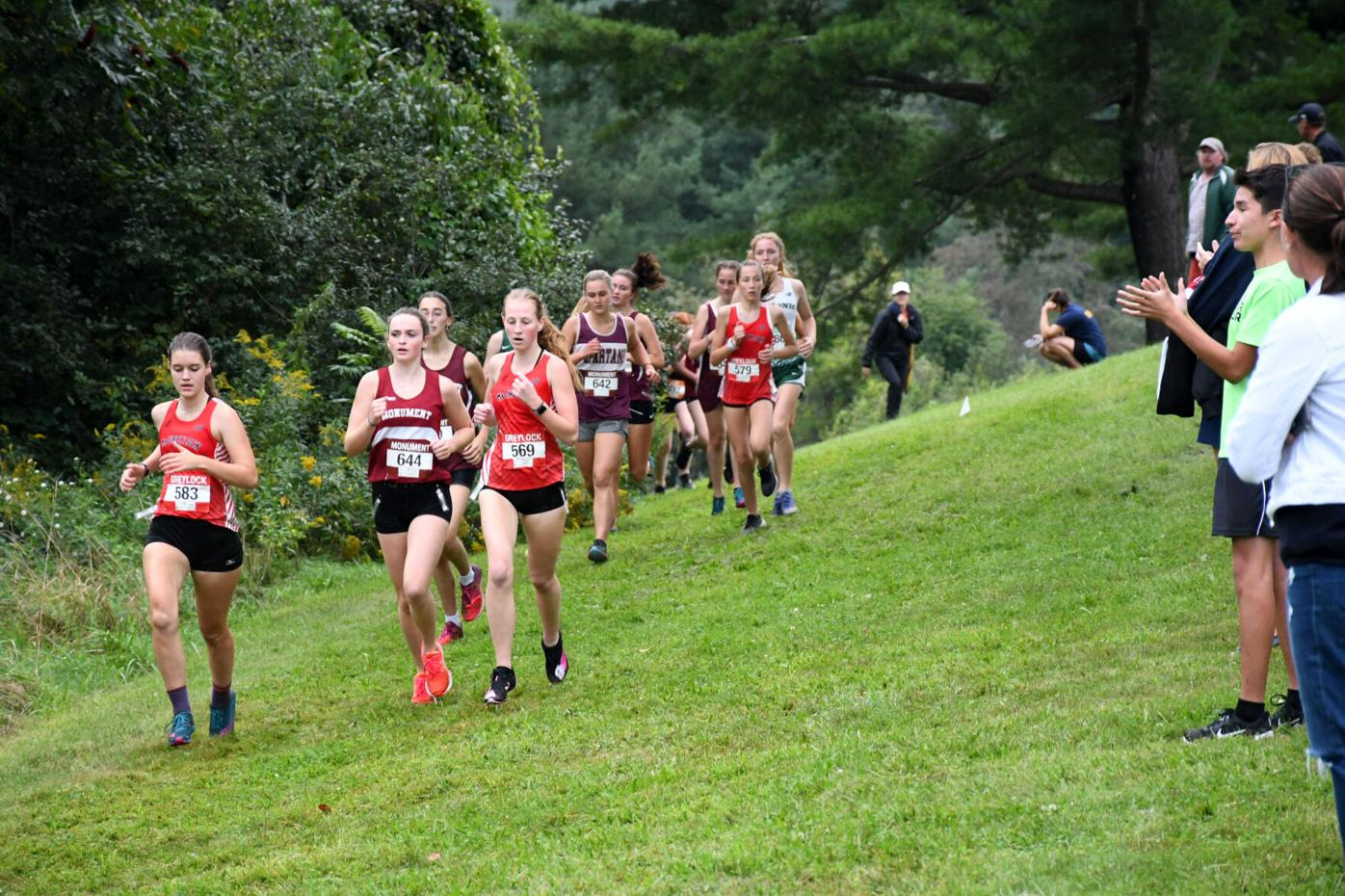 Girls run the course as fans cheer on