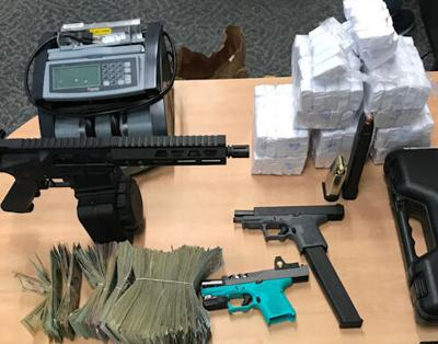 Heroin and guns seized Pittsfield