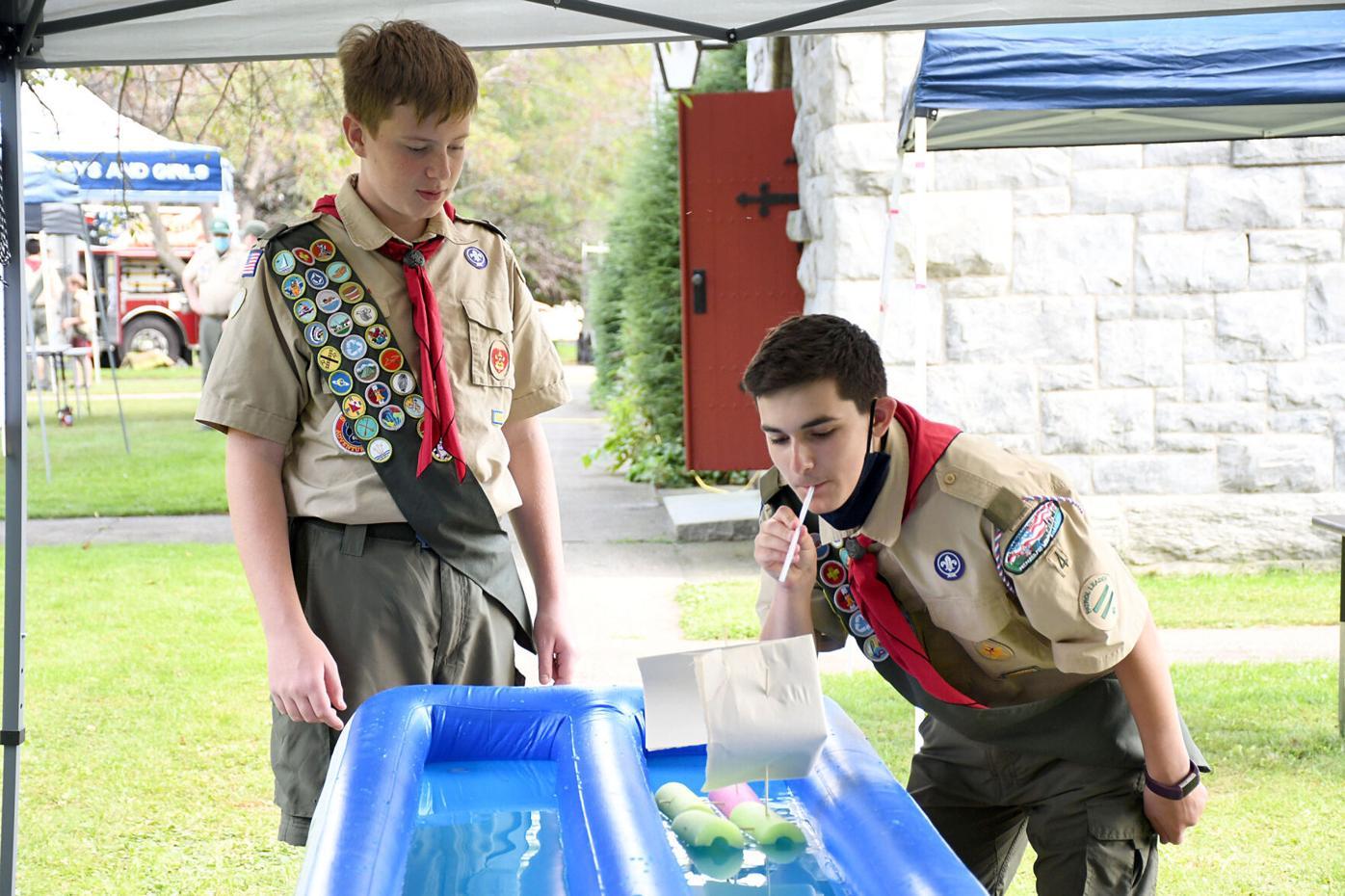 Two scouts do the raingutter regata
