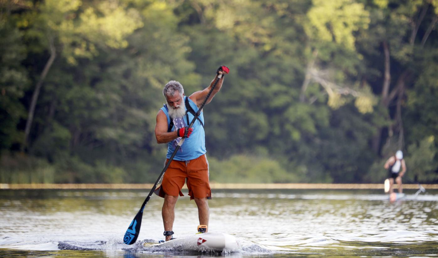 Mike Armstrong paddles on stand up paddle board