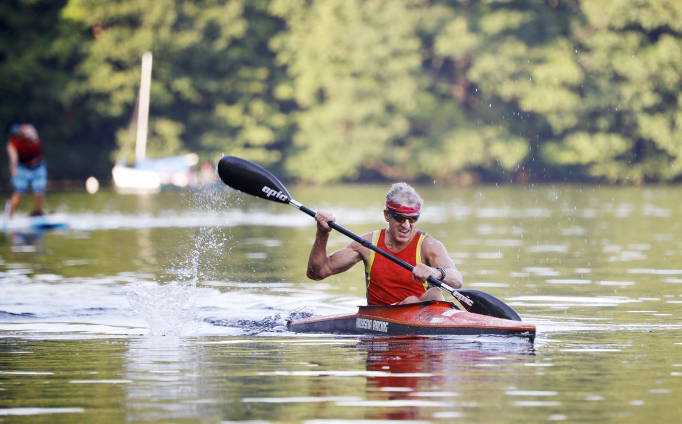 Kurt Kuehnel paddles in red kayak