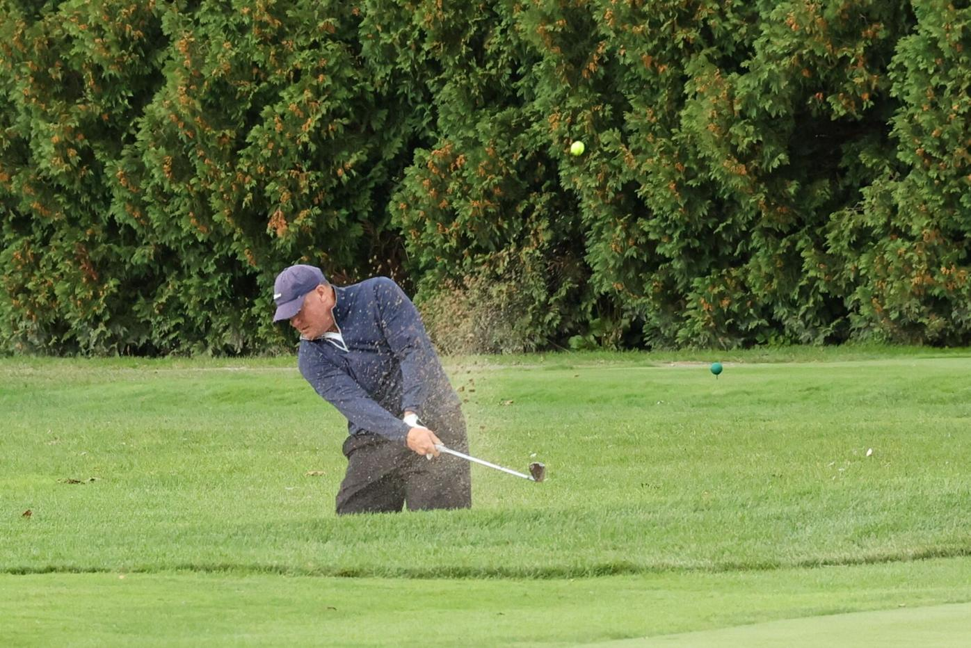 brian foley hits out of a bunker