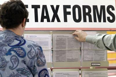 Person picking up tax forms