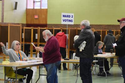 People pick up their ballots