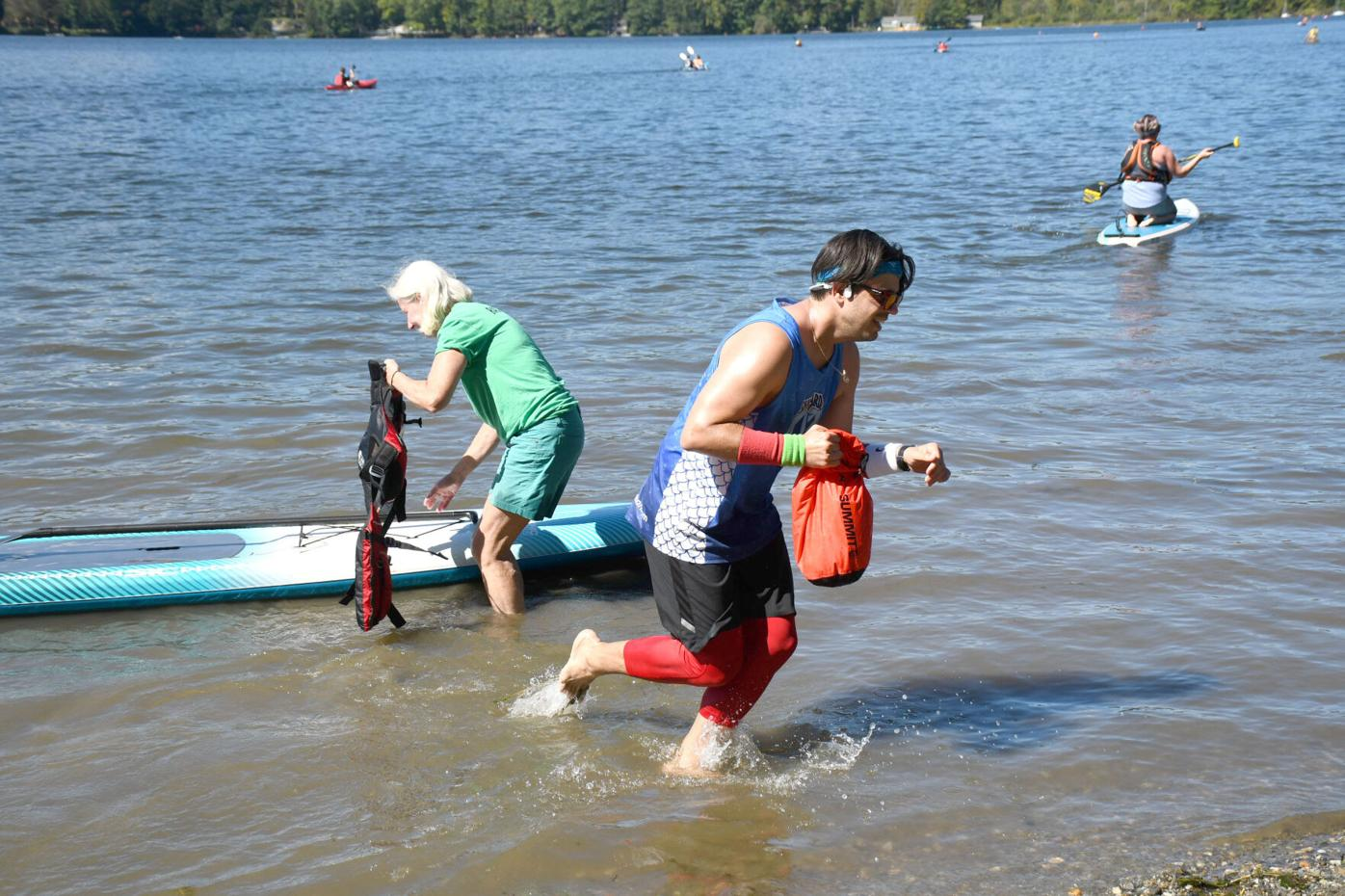 Mike rushes to shore from his paddleboard
