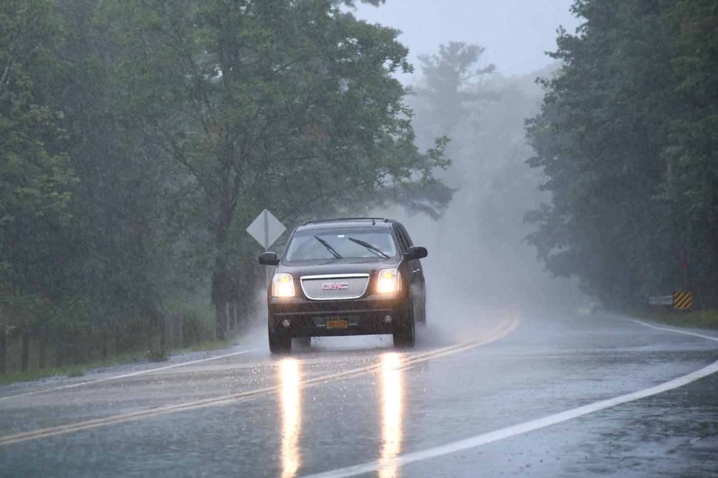 An SUV navigates the storm