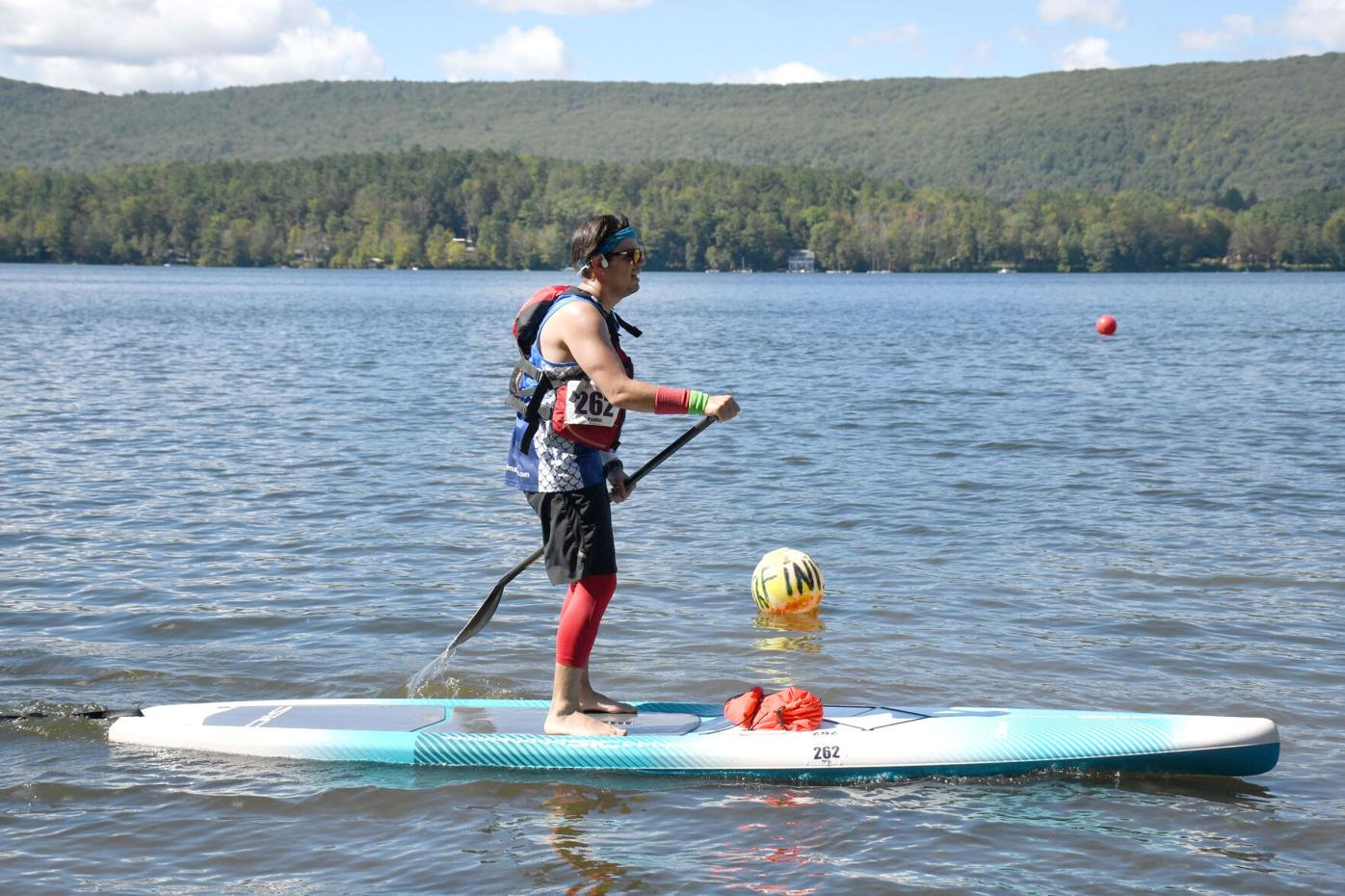 Mike paddleboards to shore