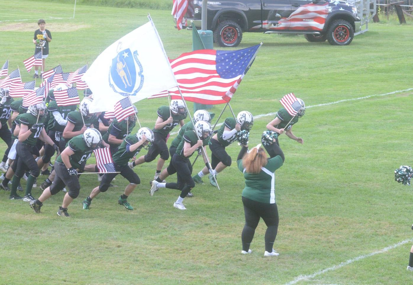 Hornets storm onto field with flags