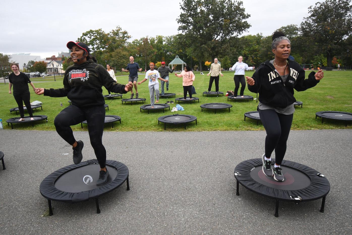 People jump on mini trampolines