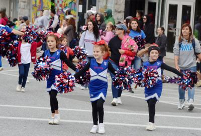 Children dance in parade