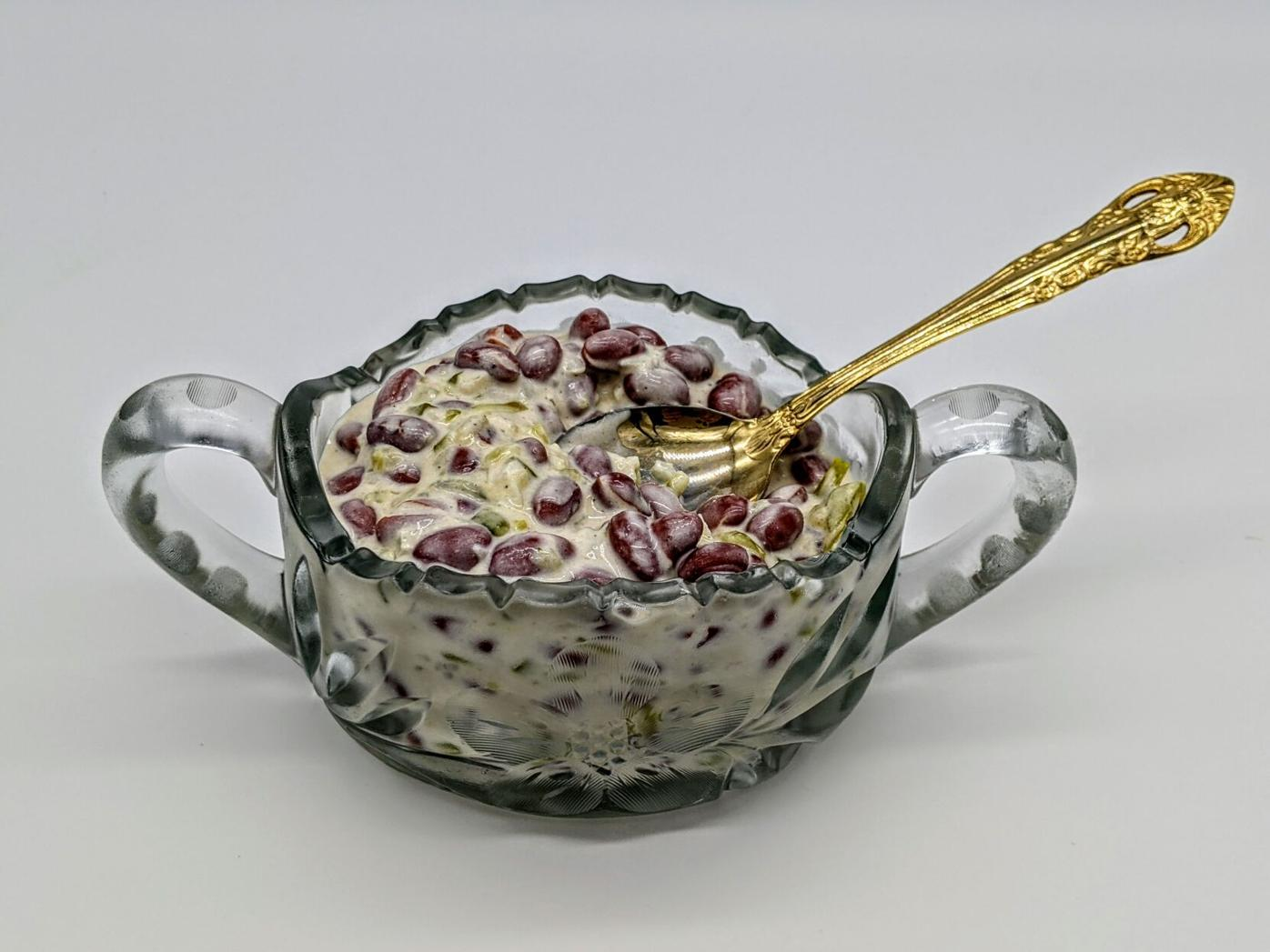 kidney bean salad in glass bowl with serving spoon