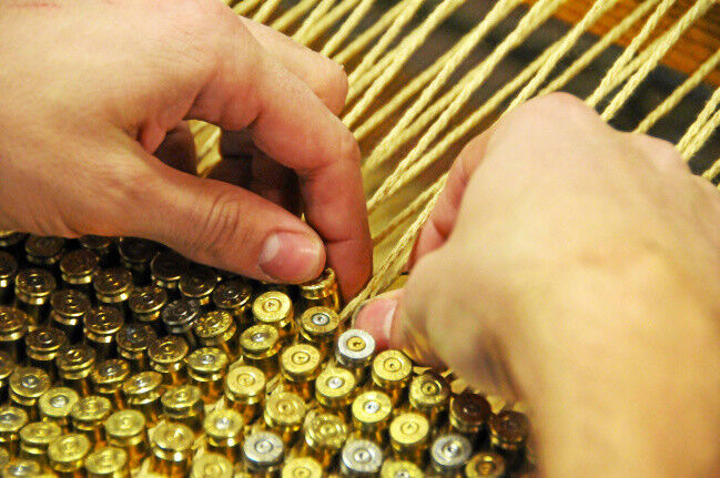 Rug made of .40 caliber bullet casings weave stories of 'war, violence, military interventions'