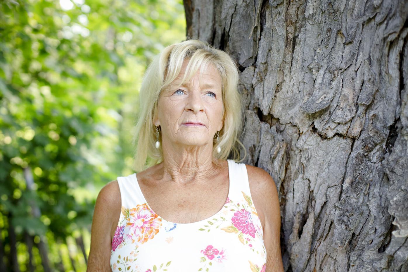 Sheri Biasin leaning against tree