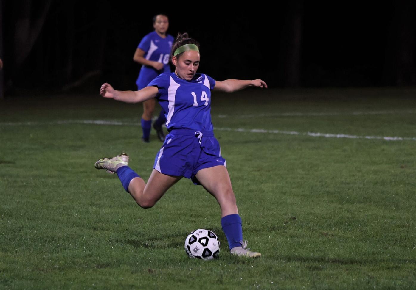 anna naef kicks the ball